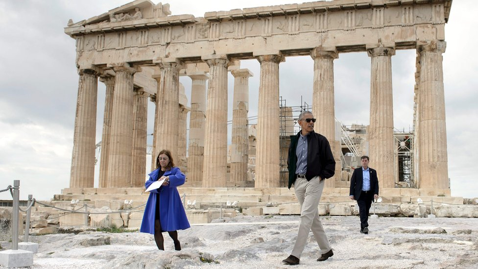 US President Barack Obama walks in front of the Parthenon during a tour of the Acropolis on November 16, 2016 in Athens, Greece