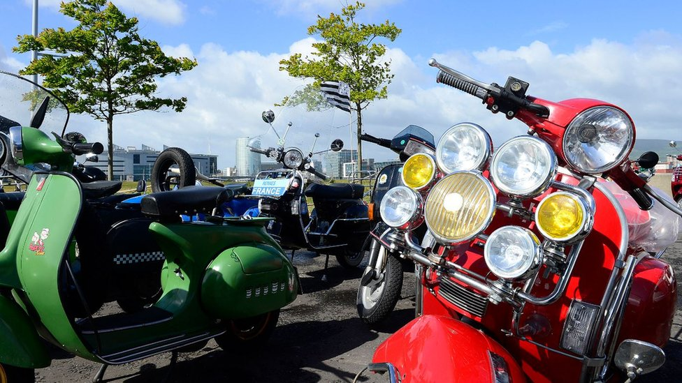 Carrickfergus Castle besieged by 3000 Vespa scooters