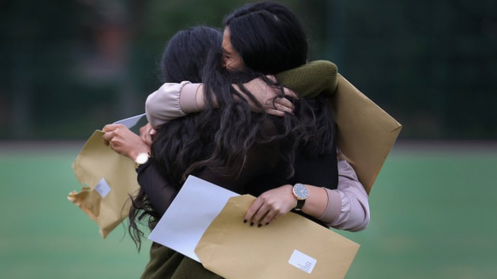 GCSE girls hugging