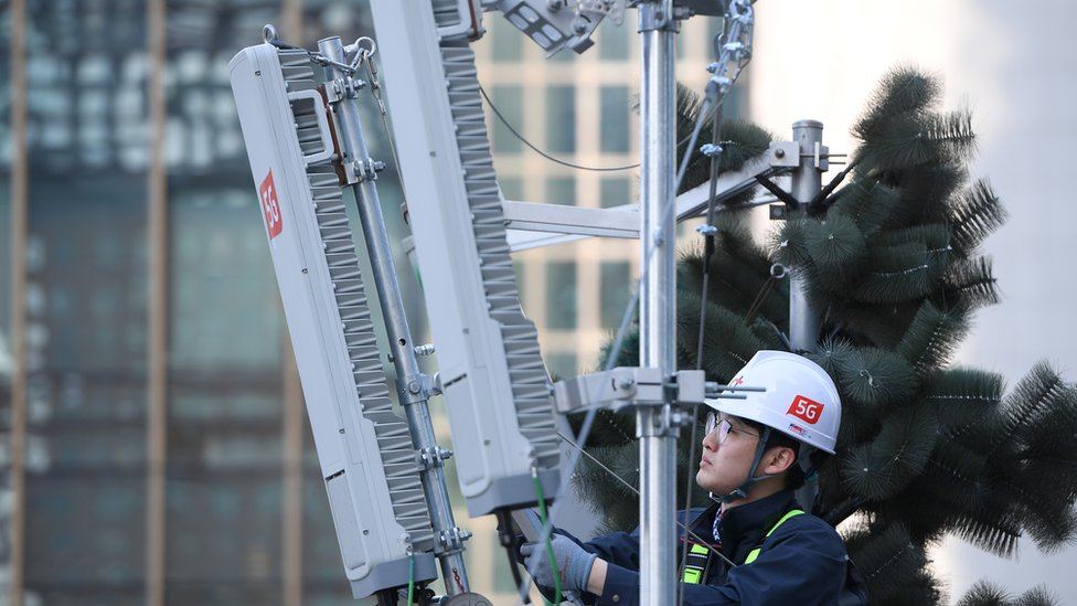 Technician checks 5G antenna in Seoul in April 2019