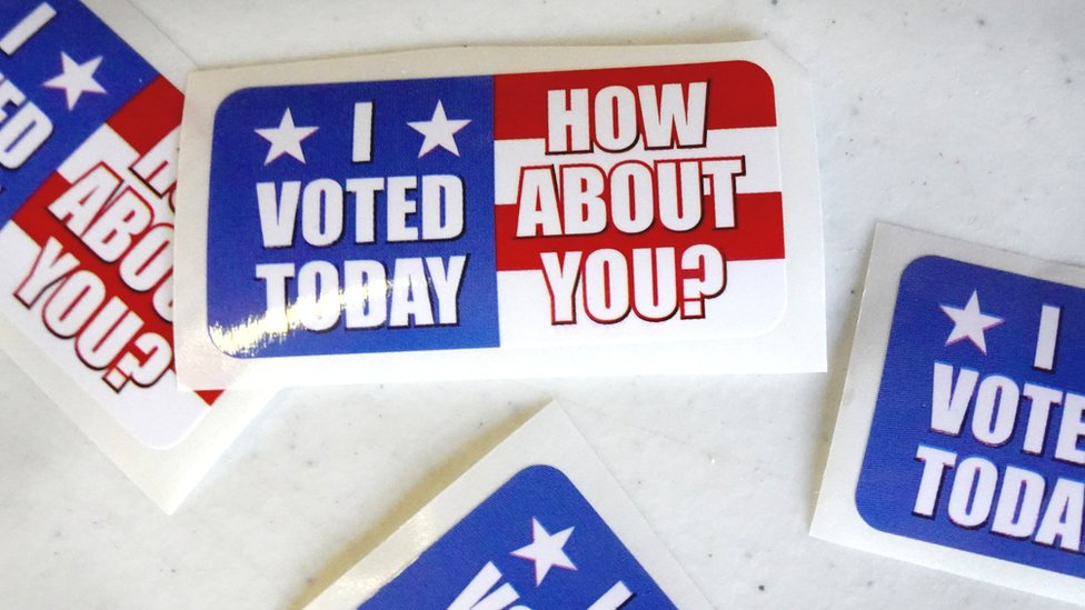 Stickers sit on a table at the Wicker Park Social Center polling place during the first day of early voting in Indiana on October 06, 2020 in Highland, Indiana.