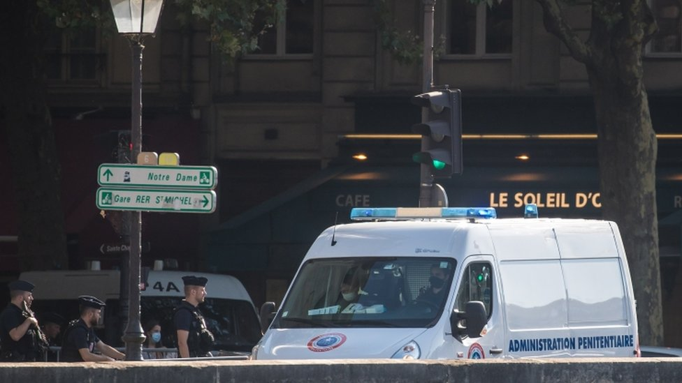 French police officers secure a convoy believed to be transporting suspects