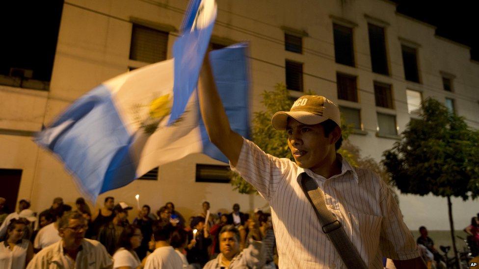 A protestor demands President Perez Molina resign