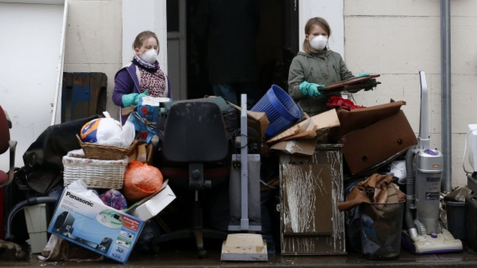 Residents and shop owners clear all their belongings onto the streets of Tadcaster