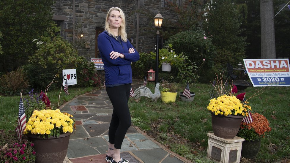 Dasha Pruett, a candidate for Congress and a Trump supporter, standing in front of her house