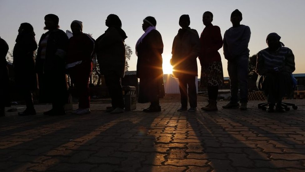 People stand in a queue to cast their vote during the municipal elections in Alexandra township, Johannesburg, South Africa, 03 August 2016.