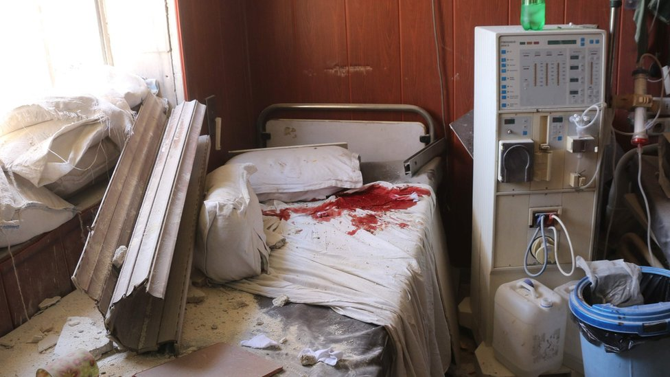 Blood-stained bed inside a hospital the rebel-held Maadi district of Aleppo reportedly hit in an air strike (16 July 2016)
