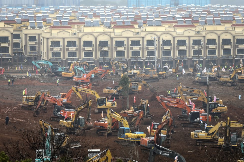 A view of cranes and diggers building Huoshenshan Hospital