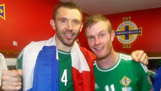 Gareth McAuley celebrates with Chris Brunt