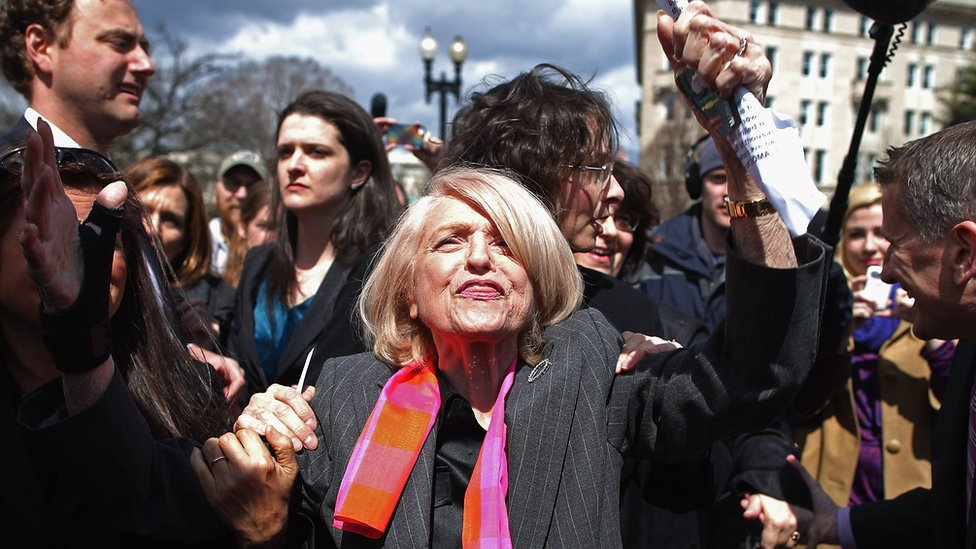 Edith Windsor is mobbed by journalists and supporters as she leaves the Supreme Court in Washington DC, 27 March 2013