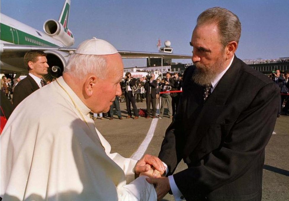 Castro, right, greets Pope John Paul II at the Jose Marti Airport on January 21, 1998. The visit was long-delayed and much anticipated.