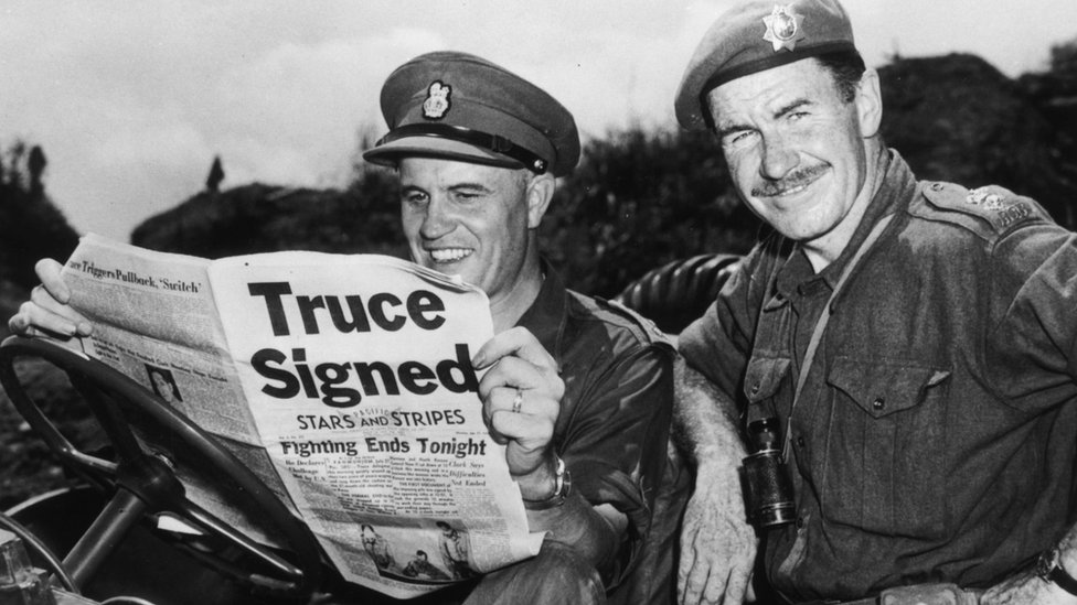 Brig Jean Allard, commanding officer of the Canadian Brigade, breaks the news of a truce in the Korean war to Col K L Campbell, commander of the 3rd battalion of the RCRS, on 2 August 1953