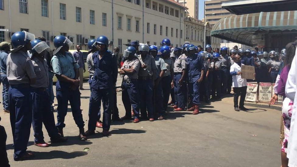 Riot police pictured in Harare