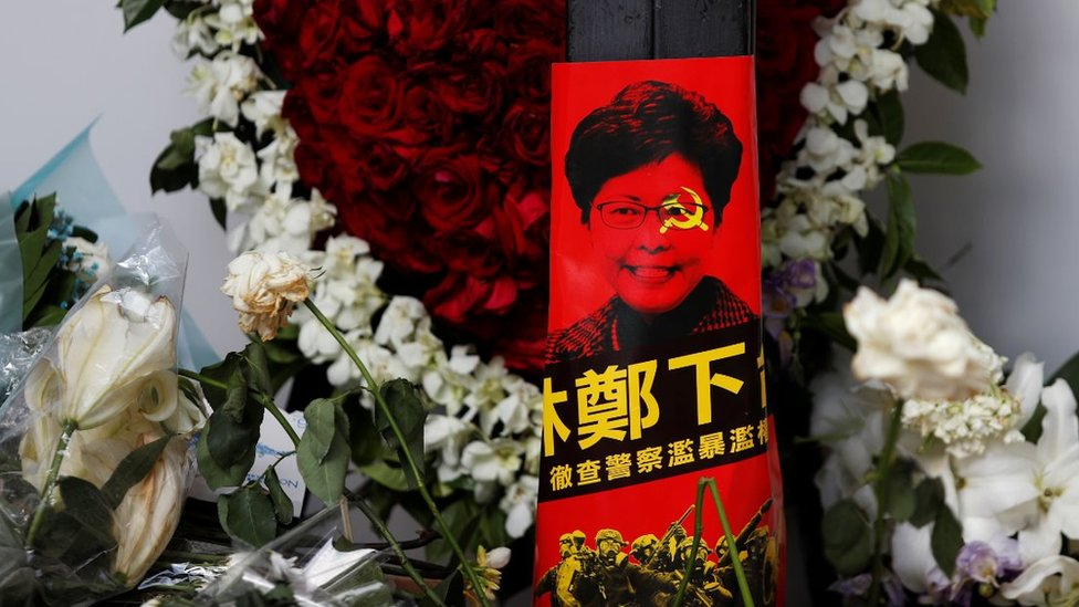 Picture of Carrie Lam with hammer and sickle across her face