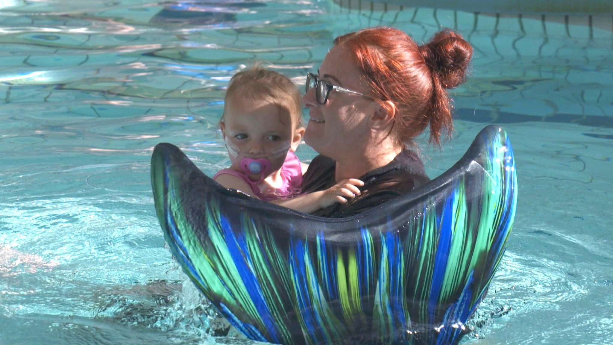 Seriously ill children swimming with mermaids in Aberdeen