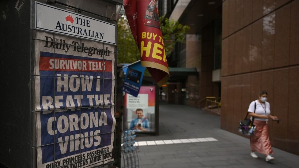 A kiosk displaying the front pages of The Daily Telegraph newspaper in Sydney