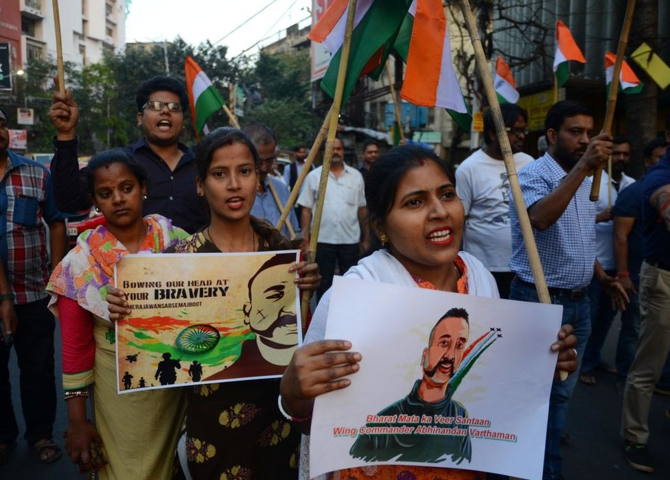 People holding posters of Wing Commander Abhinandan Varthaman celebrate his return at a rally in Kolkata on 2 March 2019.