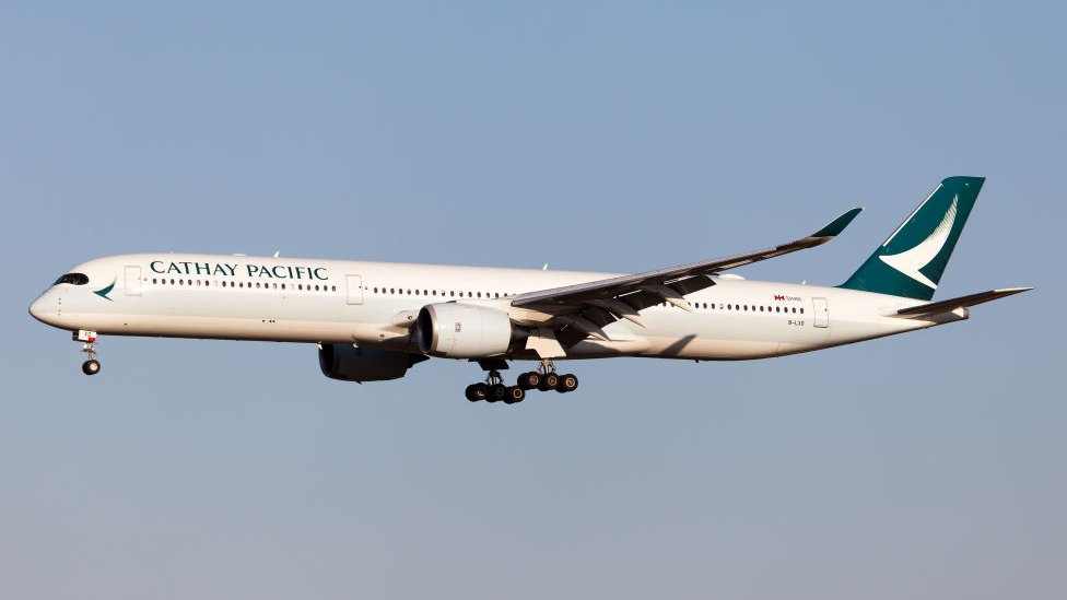 A Cathay Pacific Airways Airbus 350-1000 landing at Rome Fiumicino airport.