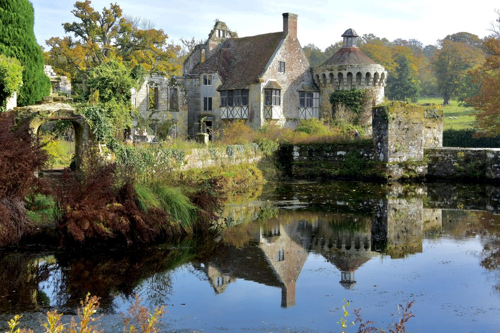 Scotney Castle reflected in water