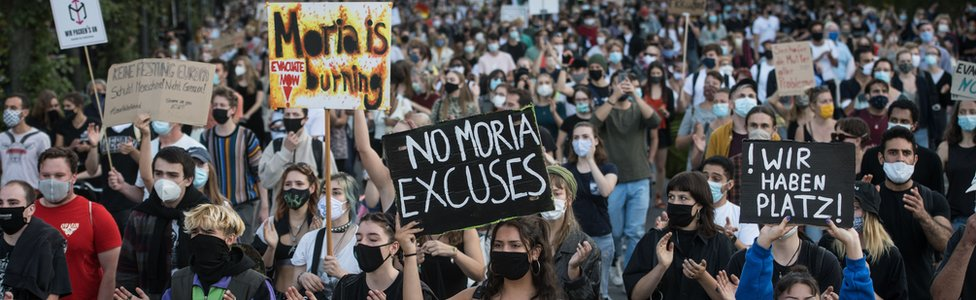 Protesters march during a demonstration for the evacuation of all migrant camps in Greece