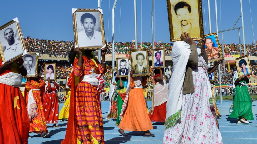 People parade photos of their relatives who died during the Tigray People's Liberation Front's (TPLF) 17-year struggle against the military regime in Mekelle - 19 February 2020