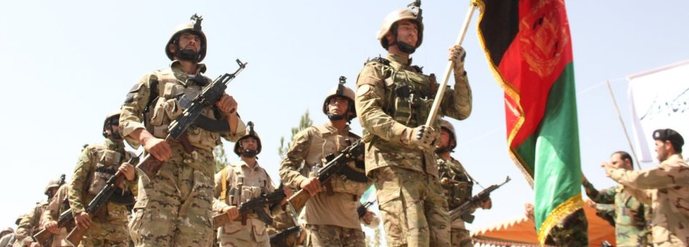 Afghan security forces pictured during a military march