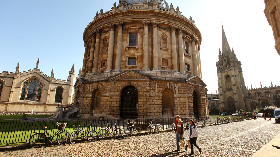 People walking past a building at University of Oxford