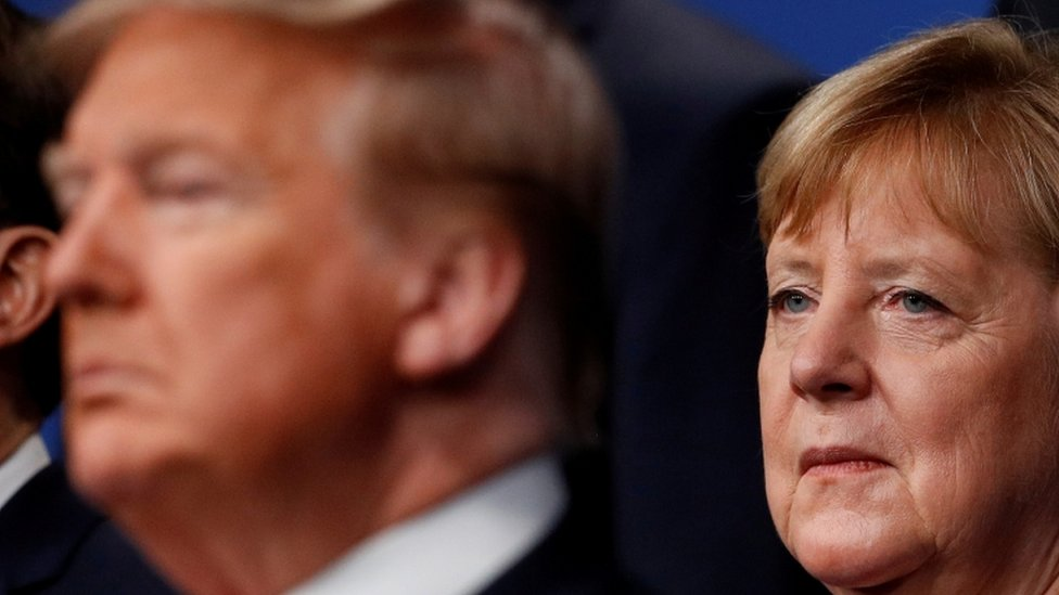 Donald Trump y Ángela Merkel.