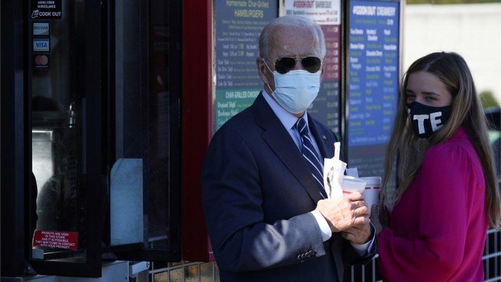 Joe Biden and granddaughter Finnegan Biden hold milkshakes in North Carolina