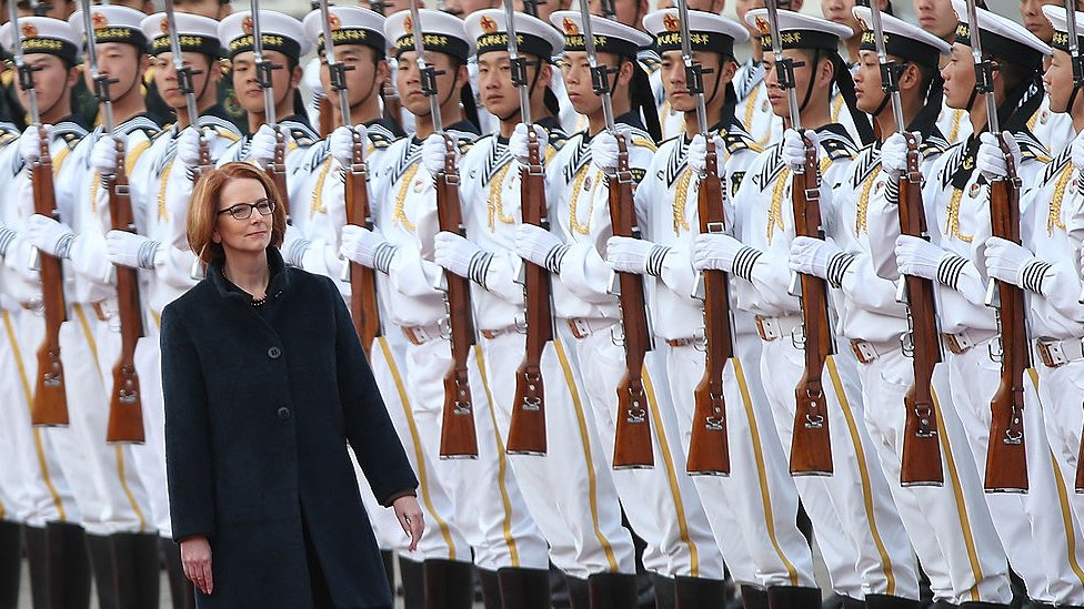 Julia Gillard walks by assembled Chinese soldiers during a welcome ceremony on an official visit to Beijing in 2013