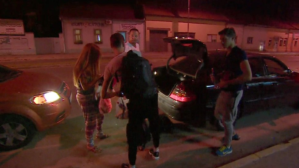 Nour and her friends get out of a car 10 miles from the Hungary border