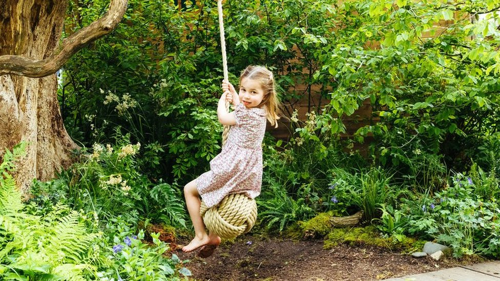 Royal children play in Duchess of Cambridge's garden