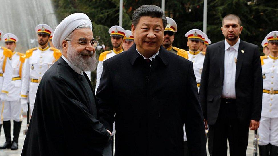 中國國家主席習近平和伊朗總統魯哈尼。