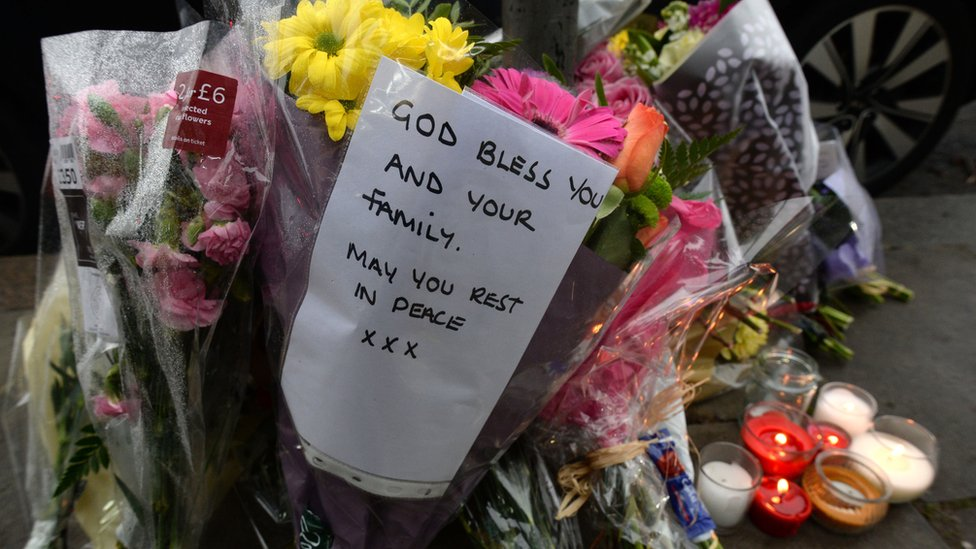 Flowers left in tribute after a shop worker was murdered in January