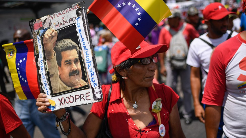 Government supporters attend a rally in the surroundings of Miraflores Presidential Palace in Caracas