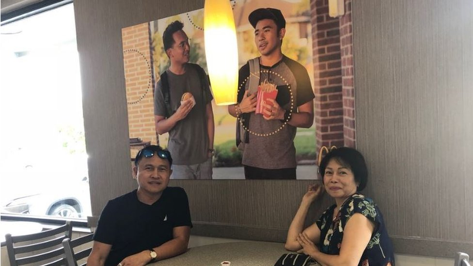 Jevh's parents pose with the photo