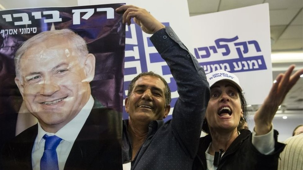 Likud Party supporters react to Israeli Prime Minister Benjamin Netanyahu's speech on 4 March 2019 in Tel Aviv, Israel.