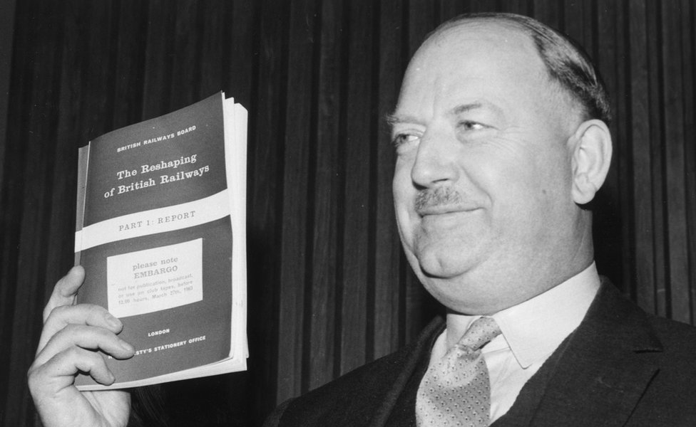 Richard Beeching holding a copy of his report in March 1963