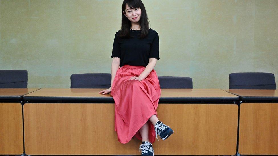 Yumi Ishikawa sits in trainers