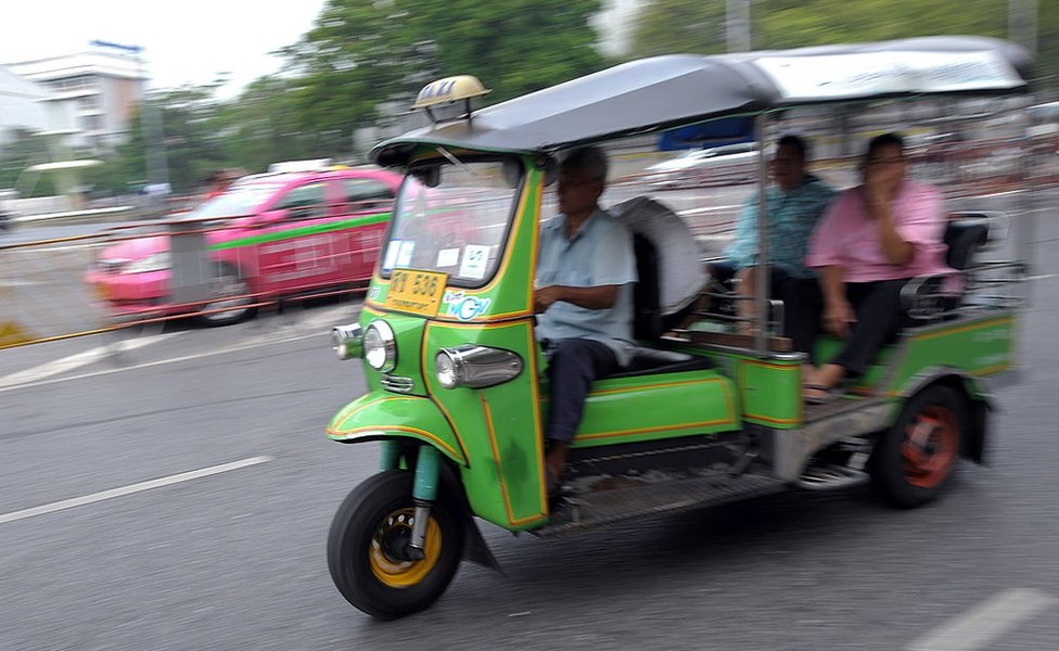Passengers are transported on a 'Tuk-tuk' at the central Bangkok on 20 January 2010.