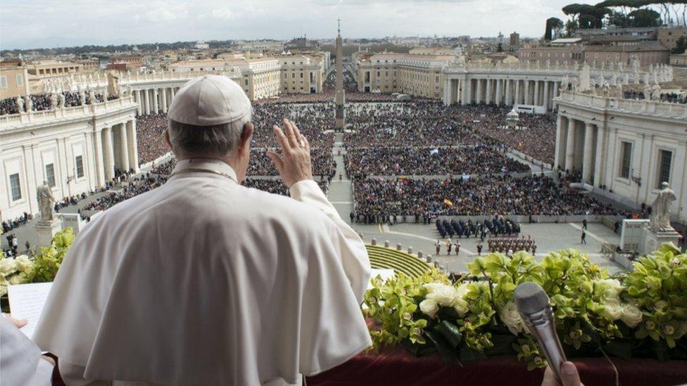 Back shot of Pope addressing crowds for Easter address