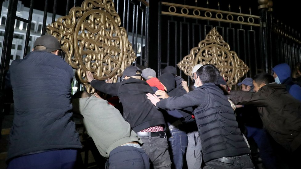Opposition protesters against the parliamentary election results storm the gates of the Government House in central Bishkek, Kyrgyzstan, 5 October 2020