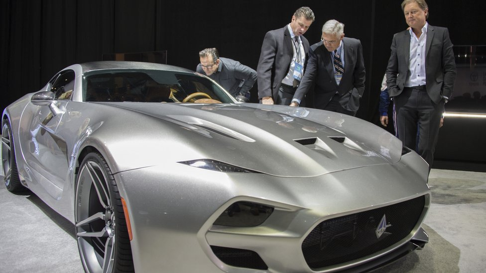 Gilbert Villarreal (2nd L), Bob Lutz (2nd R), and Fisker co-founder and namesake Henrik Fisker (R) unveil the VLF Coupe during the VLF press conference at the North American International Auto Show in Detroit, Michigan