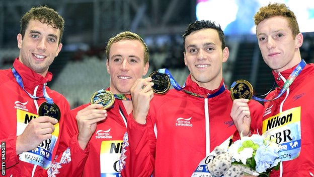 Britain's team members celebrate victory in the men's 4x200m freestyle relay