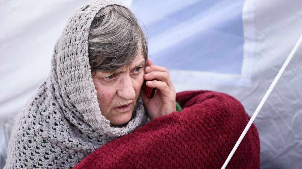 Woman in makeshift camp in Durres