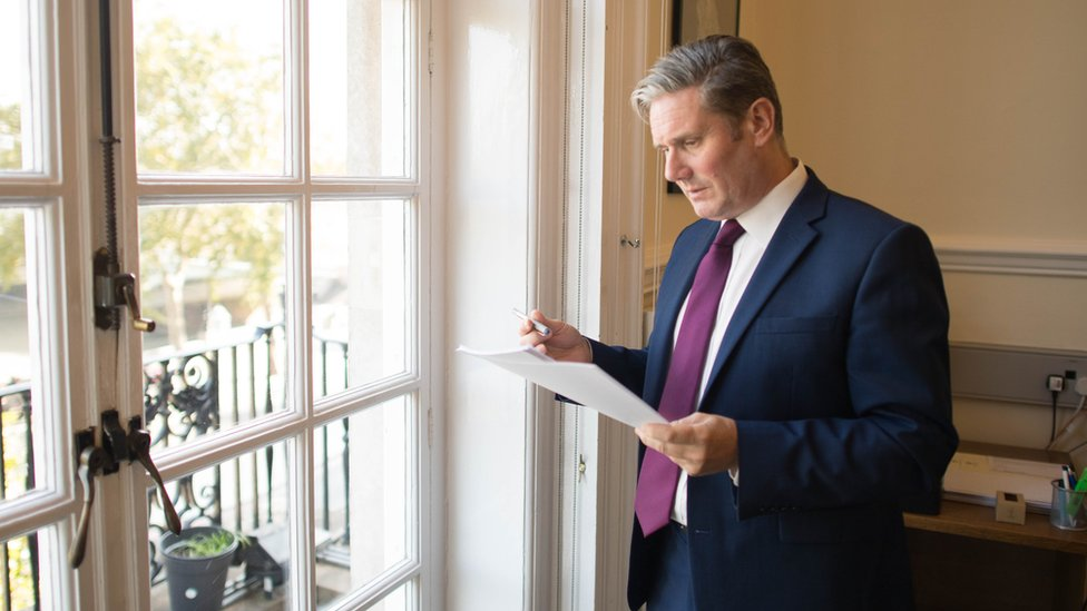 Sir Keir Starmer reads his conference speech