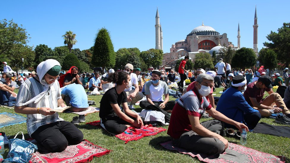 Worshippers laid out prayer mats outside the Hagia Sophia, waiting for the opening ceremony