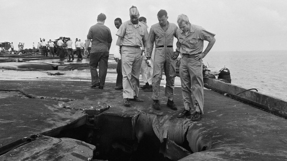 John McCain (r) surveying the damage to the USS Forrestal