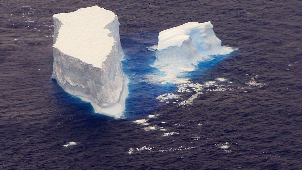 An iceberg floating in the ocean