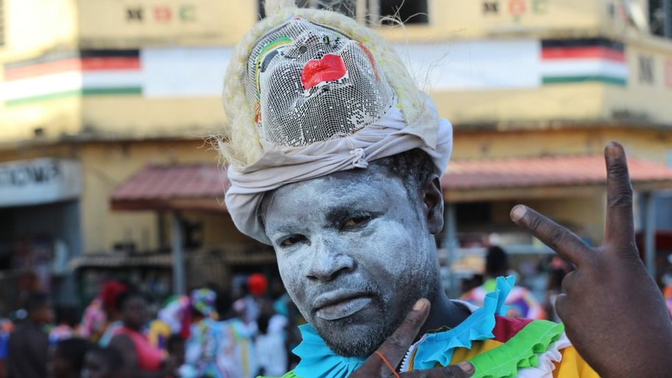 Man with face whitened by talcum powder in Sekondi Ghana